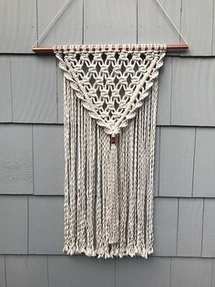 All of the wall hangings here at Driftwood Family Studios are handcrafted with love by Jeanie, our fiber artist. Jeanie designs and creates her pieces from her studio in Davenport, Iowa. She draws inspiration from nature, incorporating natural elements into her pieces, including many