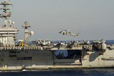MEDITERRANEAN SEA (Oct. 23, 2013) – A MH-60S Helicopter from the Screaming Indians of Helicopter Sea Combat Squadron 6, prepares to land on the aircraft carrier USS Nimitz (CVN 68). Nimitz is deployed supporting maritime security operations and theater security cooperation efforts in the U.S. 6th Fleet area of operations. (U.S. Navy photo by Mass Communication Specialist 2nd Class Corey Hensley)