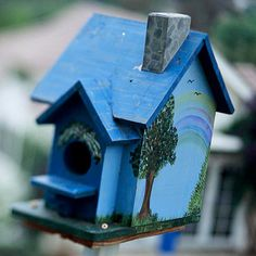 Add Ornamentation.   Use garden ornaments -- from birdhouses to statuary -- to embellish your garden. Anything goes -- as long as it suits your personal style. This blue birdhouse does double duty: It looks good and provides a spot for birds to live.