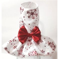 This beautiful small dog dress has an overlay of shimmering red snowflakes on it and a matching big red bow.