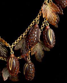 Amber Bakelite Pine Cone / Oak Leaves Necklace http://www.etsy.com/listing/28265772/ultra-rare-ooak-bakelite-necklace-carved
