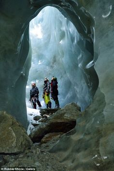 Plummeting to new depths: Spectacular ice caves photographed for the first time deep beneath a Swiss glacier
