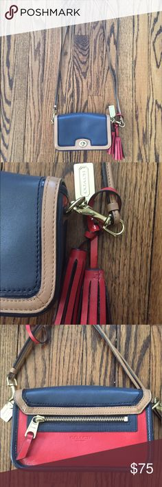 Coach Leather Color Block Crossbody Bag Beautiful navy, red, and tan Crossbody bag. Claspe closure with a variety of pockets and back zipper. Good condition and has only been worn a couple times. Dust bag included. Coach Bags Crossbody Bags