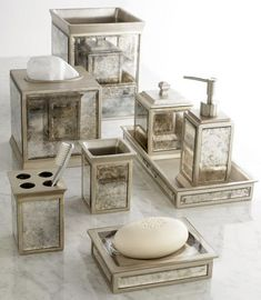 Beautifully Coordinated Set Of Bath Accessories The Mirrored Panels And Vintage Look Make For