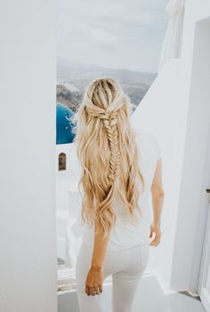 all white in Greece with a perfect braid