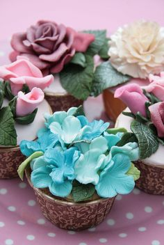 Beautiful cupcakes covered in bright colored sugar flowers Floral Cupcakes, Pretty Cupcakes, Beautiful Cupcakes, Yummy Cupcakes, Elegant Cupcakes, Cupcake Art, Cupcake Cookies, Rose Cupcake, Tolle Cupcakes