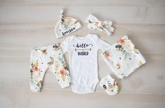 This adorable baby girl coming home set features earth tone watercolor flowers printed on an organic cotton knit fabric! This coming home set includes your choice of the full set shown in the photo or any combo of the following pieces: leggings, knot top hat with option for
