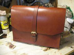 Nice plain briefcase. $235. Want!