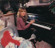 Stevie Nicks, and one of her dolls watching