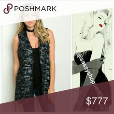 """'EVA' Black with metallic sheen fur vest New with tags,PRICE IS FIRM  Add a new twist to your fur vest collection with this glamorous belted faux fur vest featuring a dazzling silver metallic sheen on soft black faux fur! Pair with leggings, comfy sweater & boots! Material is light weight & does not add weight when wore, it is so chic!  Side pockets Fully lined  60%polyester/40%PUC, light weight vest Small Bust 19"""" across Length 30""""   Medium Bust 20"""" across Length 32"""" Large Bust 21.5"""" across…"""