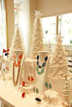 Great jewelry display  just substitue the white trees for green ones to make it an all season display ISM Shop Ideas |Jewelry - Daily Deals| jewelry display