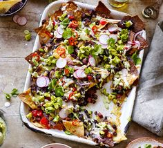 The perfect snack for sharing, who could resist this mounatin of cheesy nachos topped with lime-spiked guacamole? Put the Mex-factor into your Saturday night