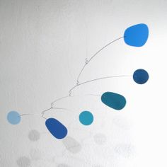I've wanted some hanging art for a while now. This one is nice. Konrad's Mobiles - Am I Blue Mobile, $99.00 (http://www.konrads.com/am-i-blue-mobile/)