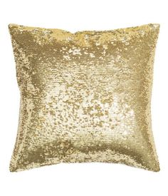 Cushion cover in cotton fabric with a sequined front, solid-color back, and concealed zip.
