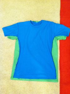 Turn a too-big shirt into one that fits!! Trace smaller shirt onto bigger shirt. Sew along the lines & cut off the extra!!