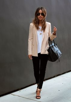Julie Sarinana is wearing a nude blazer from Aritzia, T-shirt from Urban Outfitters, black suede skinny jeans from Anine Bing and shoes from Celine