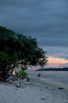 beach & fire. evening on gili meno, bali.