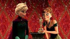 Anna giving Elsa the Oscar