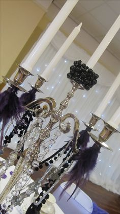 Love the hanging accents on the candelabra - inspiration idea for the 2 silver candelabras