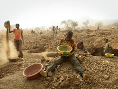 More than 2 million people in Burkino Faso are facing severe food shortages. The country has rich gold deposits and men, women and children are digging holes in the desperate hope of finding even small amounts of this precious mineral. Photo by Andy Hall/Oxfam