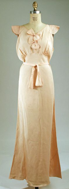 Rayon Nightgown. Date: 1945–49 | metmuseum.org.  Adorable quilted/corded cap sleeves and self-fabric bows.
