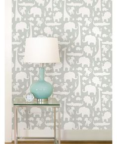 Transform a room with ease with this simple to use It's A Jungle peel and stick wallpaper. The gorgeous design features white silhouettes of animals including monkeys, lions and giraffes on a soft grey background. Ideal for nurseries and bedrooms, simply peel the backing off and apply the high quality wallpaper to any flat surface.