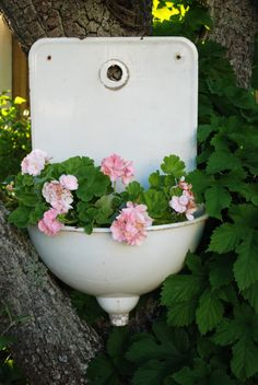 pretty on a garden wall, or tree.  sink with pink flowers I have an old sink I could spray paint it white and add some flowers