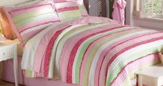 The Anna's Ruffle Quilt Set is decorated with hand-crafted horizontal stripes, floral prints, and ruffle highlights in bright and fun shades of pink and green. Even better, this quilt is comfy and soft with a prewashed cotton cover. Ruffle Quilt, Striped Quilt, Striped Bedding, Ruffle Bedding, Quilt Bedding, Rag Quilt, Daybed Bedding, Ruffle Pillow, Peach Bedding