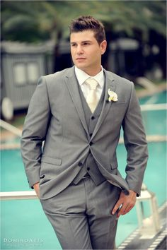 Groom's suit... excluding the boutonniere. White tie for Chris, dark grey for groomsmen?