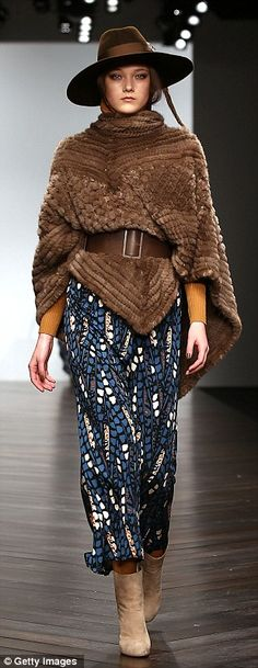 Lady of the ranch: Suede boots and fur poncho nod to country Western influences