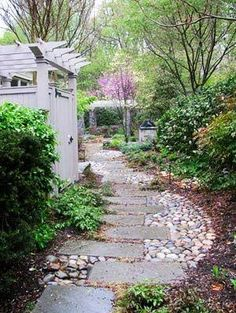 Hmmm, for side/back yard? Beautiful garden path .. mixes stepping stones and river rocks ...