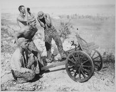 Marines fire captured mountain gun during the attack on Garapan Saipan 21 June 1944.