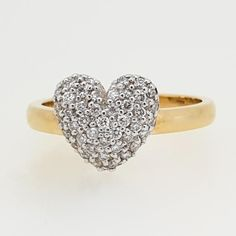 This stunning ring features 0.25ct TDW of diamonds pave set in a 9ct white gold heart in a 9ct yellow gold band.   Based in Brisbane, Queensland, Our team have been designing and hand-crafting Quality Individual Jewellery for over 4 decades. Sourcing the most beautiful, precious Gems, each piece is designed and crafted by our experienced jewellers and the Gems set by our in-house experienced Gem setter.   As each piece is hand-crafted, you can be assured your Jewellery will last generations. Gold Rings Jewelry, Heart Jewelry, Cute Jewelry, Diamond Heart, Heart Ring, Gold Heart, Diamond Rings, Hipster Accessories, Accessories Jewellery