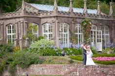 a beautiful gothic orangery with some wedding people