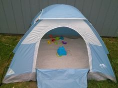 Tent filled with play sand–shade for the little, zip up to keep out cats, rain flaps to keep dry!