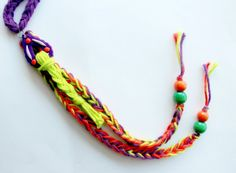 Knit necklace with polymer clay pendant tassel by FruitofPhalanges