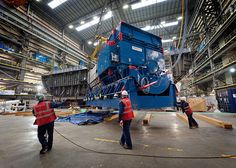 Lifting the diesel generator sets into place on HMS Prince of Wales, Portsmouth, October 2012 by QEClassCarriers, via Flickr