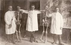 Vintage Photo of Three Doctors or Medical Students Wearing Lab Coats and Posing With Skeletons
