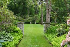 Stone columns flank both entrances to a large lawn.  A Planters Design.  Highlands, NC
