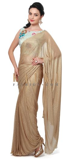 Buy Online from the link below. We ship worldwide (Free Shipping over US$100). Product SKU - 315468.Product Link - http://www.kalkifashion.com/gold-shimmer-saree-matched-with-floral-printed-blouse-only-on-kalki.html
