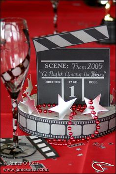 Movie theme decorations at a table celebrating a high school prom. copyright © James O'Rear all rights reserved Deco Theme Cinema, Cinema Party, Movie Party, Movie Themed Parties, Movie Theme Decorations, Movie Themes, Hollywood Party Decorations, Red Carpet Theme, Red Carpet Party