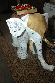 Paper Mache Elephant project on Craftsy.com Give him purple tone. Green brown and blue henna design.