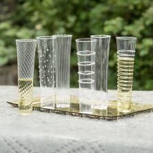 Our uniquely lovely glass champagne flutes set turns any drink into a toast.