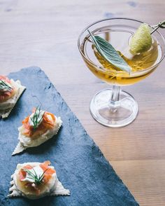 Cheese & Cocktail Pairings.Slices of Bijou buttons topped with smoked salmon and a dollop of crème fraiche make for a festive bite.  Pair with this side ride cocktail finished with sage & fresh lemon peal.  #wrinklesaresexy