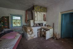 Lives left behind: Families were forced to leave nearly all of their possessions behind when the town was evacuated. Today, houses still stand with food in the cupboards and sheets on the unmade beds