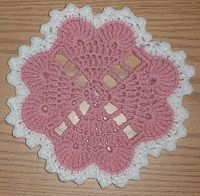 Crochet heart doily. I'm thinking it might look good in green too for St. Patrick's Day.