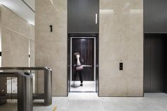 Lift Car / Lift Lobby / Graphic at China Square Central, Singapore by DP Design
