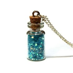 Mermaid Scales Necklace. A jar full of mermaid scales in all their glittery aquatic glory hangs from a 18-inch chain in this charming creation by young designer Stephanie Zheng. Carrying a little bit of magic never hurt anyone…$29