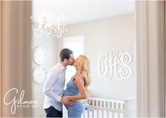 On Location: In home Maternity Session - Newport Beach Photographer, Newport, CA, Cali, California, new home, pregnant, maternity, sky blue dress, maxi dress, pregnant belly, beautiful couple, neutral tones, neutral colors, blonde, red nail polish, manicure, nursery, kiss in nursery, initials, chandelier, crib, holding belly GilmoreStudios.com