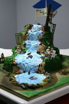 Hunting And Fishing Paradise I made this cake for my nephews seventh birthday. He loves to hunt and fish. His mom bought the fishing and. Waterfall Cake, Bachelor Cake, Camping Cakes, Lemon And Coconut Cake, Pecan Cake, Angel Cake, Cakes For Men, Creative Cakes, Beautiful Cakes